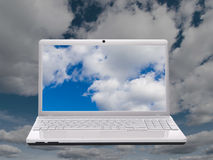 Notebook computer and sky Royalty Free Stock Photo