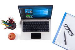 Notebook computer with windows 10 and stationery Royalty Free Stock Image