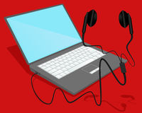 Notebook connected with earphone Royalty Free Stock Image