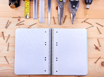 Notebook and construction tools Royalty Free Stock Images