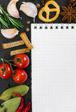 Notebook for cooking recipes and spices. On black background Stock Images