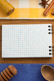 Notebook for cooking recipes on wood Royalty Free Stock Photo