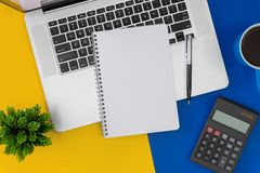 Notebook with copy space on laptop on top of office desk. Business concept royalty free stock photography