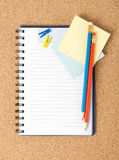 Notebook on the cork background Stock Images