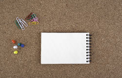 Notebook on cork background Royalty Free Stock Photo