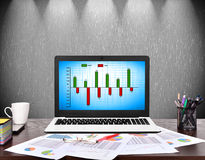 Notebook with cost chart. On screen, business concept Royalty Free Stock Images