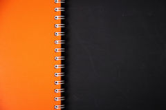 Notebook cover and blackboard background Stock Images