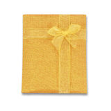 Notebook cover made of gold Linen fabric with bow for souvenir i Royalty Free Stock Photos