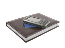 Notebook.credit ard and mobile. Closeup of brown notebook.credit card and mobile phone on it isolated over white Royalty Free Stock Images