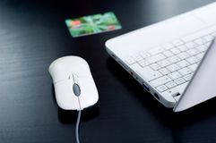 Notebook, credit card, mouse Stock Photo