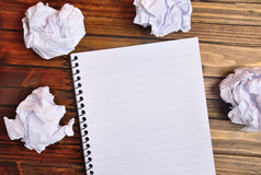 Notebook with crinkled paper. On wooden table Royalty Free Stock Images