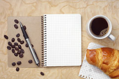 Notebook, croissant and coffee Royalty Free Stock Photos