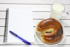 Notebook, croissant and milk Royalty Free Stock Photos