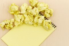 Notebook and crumpled paper Royalty Free Stock Photography