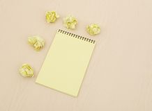 Notebook and crumpled paper Stock Image