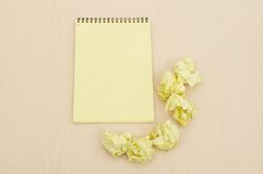 Notebook and crumpled paper Stock Photo