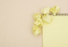 Notebook and crumpled paper Stock Photography