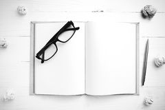 Notebook and crumpled paper black and white tone color style Royalty Free Stock Photo