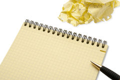 Notebook and crumpled paper wad Royalty Free Stock Images