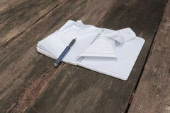 Notebook crumpled paper wrinkled blank white on the desk. Business concept stock photo