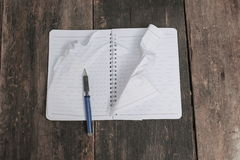 Notebook crumpled paper wrinkled blank  white  on the desk Stock Images