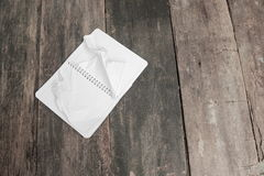 Notebook crumpled paper wrinkled blank  white  on the desk Stock Photo