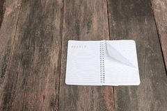 Notebook crumpled paper wrinkled blank  white  on the desk Royalty Free Stock Photo