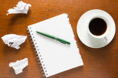 Notebook and crumpled sheets of paper Royalty Free Stock Photo
