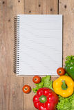 Notebook for culinary recipes with fresh organic vegetables Stock Photos