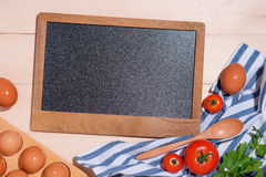 Notebook for culinary recipes with fresh organic vegetables.  stock photos