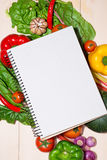 Notebook for culinary recipes with fresh organic vegetables Royalty Free Stock Photography