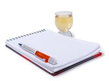 Notebook and cup Stock Images