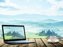Notebook and cup of cofee on table, tuscany Royalty Free Stock Photos