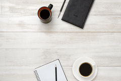Notebook, cup of coffe and pencil put on table Stock Photos