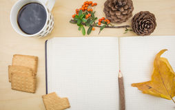 Notebook with cup of coffee autumn ornaments Stock Images