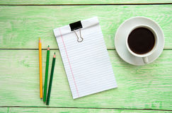 Notebook and cup of coffee Stock Photos