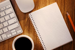 Notebook and Cup of Coffee near Computer Keyboard. On Desk as seen from Above stock images