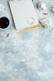 Notebook and cup of coffee over concrete background Royalty Free Stock Photo