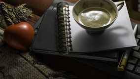Notebook with cup of coffee and red heart Stock Photo