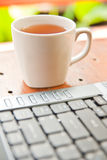 Notebook and cup of tea Stock Image
