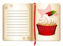 Notebook with cupcake on page Royalty Free Stock Image