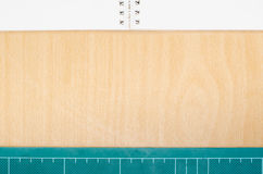 Notebook and cutting mat frame, background, wallpaper, workspace. Stationary Royalty Free Stock Images