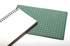Notebook and cutting mat Stock Image