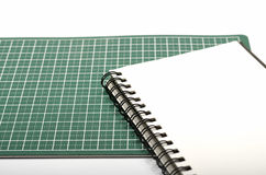 Notebook and cutting mat Royalty Free Stock Images