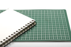 Notebook and cutting mat Royalty Free Stock Photos