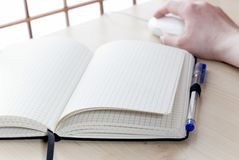 Notebook at a desk Royalty Free Stock Photo