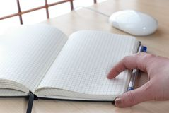 Notebook at a desk Royalty Free Stock Image