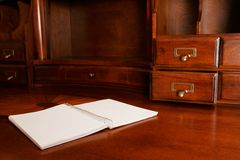 Notebook on Desk. A notebook on a wooden writing desk Stock Images