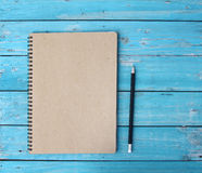 Notebook on desk Stock Photos