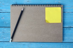 Notebook on desk Stock Photography